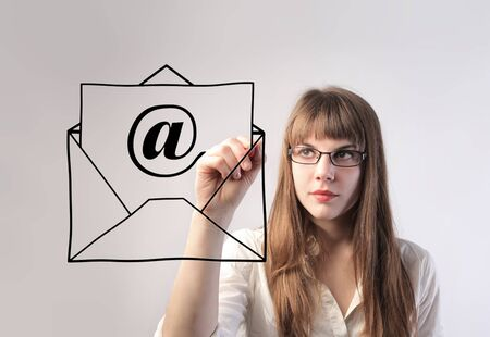 Businesswoman drawing an e-mail symbol photo