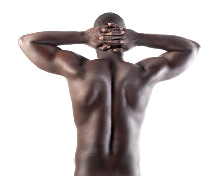 Handsome african man showing his muscles photo