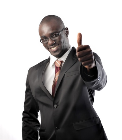 Smiling african businessman with thumbs up Stock Photo - 8856421