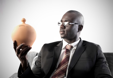 African businessman holding a money box Stock Photo - 8856440