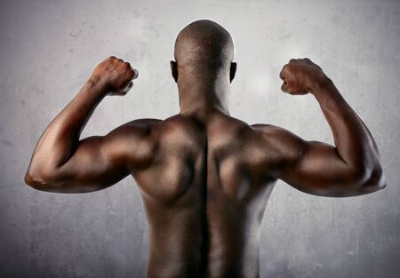 Beautiful african man showing his muscles photo