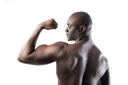 Handsome african man showing his biceps photo