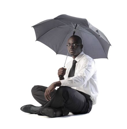 africa american: African businessman with umbrella Stock Photo