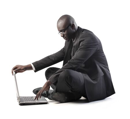 African businessman using a laptop photo