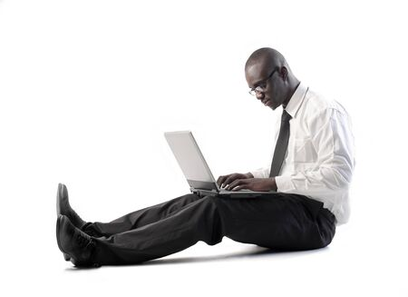 African businessman using a laptop Stock Photo - 8856420