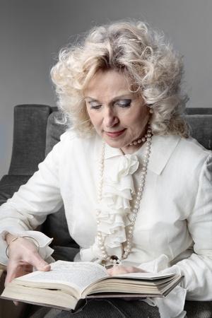 Senior woman reading a book Stock Photo - 8864314