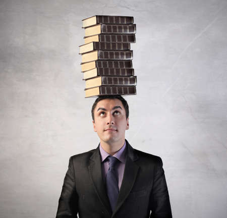 Man with stack of books on his head Stock Photo - 8999987