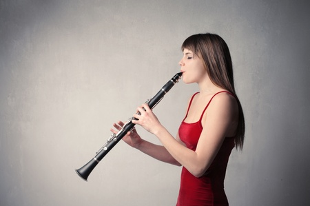 clarinet: Beautiful woman playing the clarinet