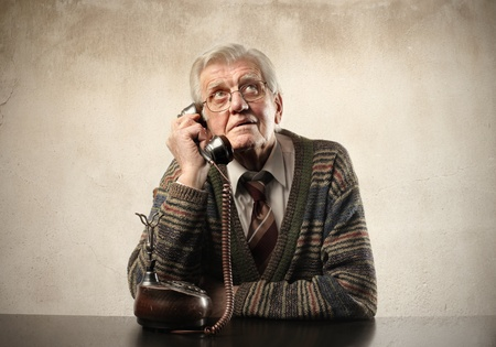 Senior man talking to telephone photo