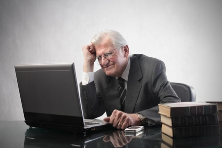 Stressed senior businessman in front of a laptop photo