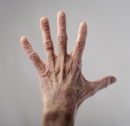 body parts man: Senior mans wrinkled hand
