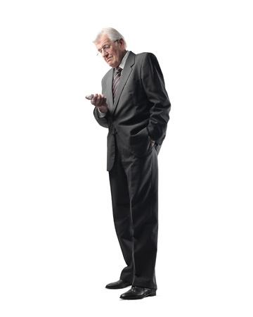Senior businessman using a mobile phone photo