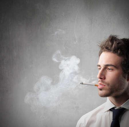Young businessman smoking