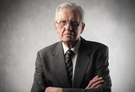 delusion: Senior businessman with angry expression