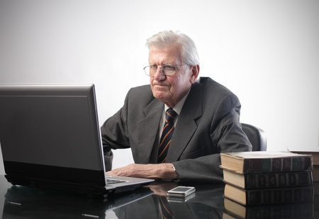 Stressed businessman using a laptop photo
