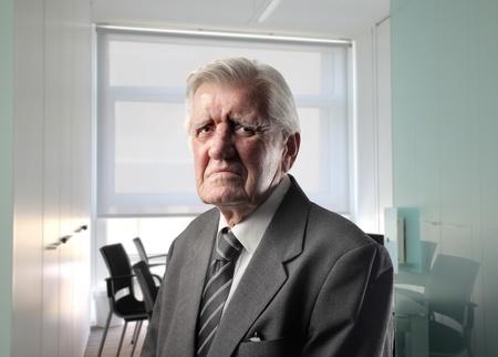 Sad senior man at the office photo