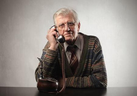 Senior man talking to telephone photo