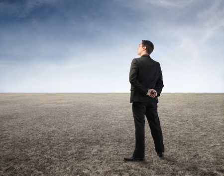 nothing: Businessman standing in a desert