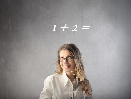Smiling businesswoman with easy calculation over her head Stock Photo - 9122206