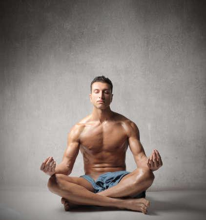 yoga man: Handsome young man doing yoga exercise