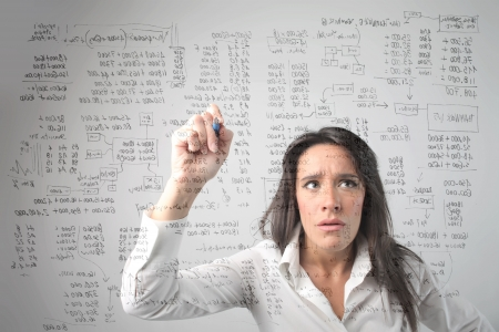 difficulty: Concentrated businesswoman solving some calculations