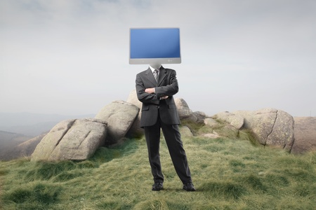 Businessman with a computer screen instead of his head photo