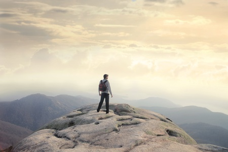 scenary: Man with backpack on the top of a mountain Stock Photo