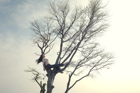 Young woman relaxing on a tree