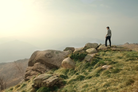 Man walking on the top of a mountain Stock Photo - 9246364