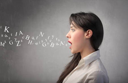speeches: Woman talking with alphabet letters coming out of her mouth Stock Photo