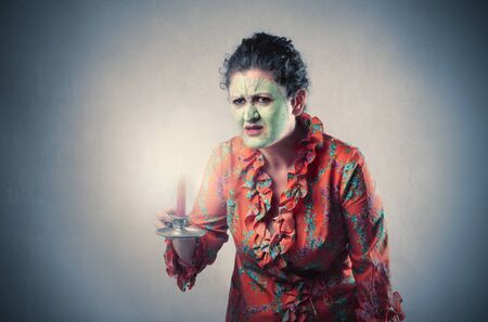 tratment: Woman wearing a beauty mask and a dressing gown Stock Photo