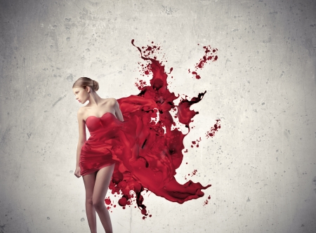 Elegant woman with dress melting in red paint