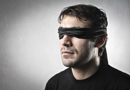 blind people: Blindfolded young man Stock Photo