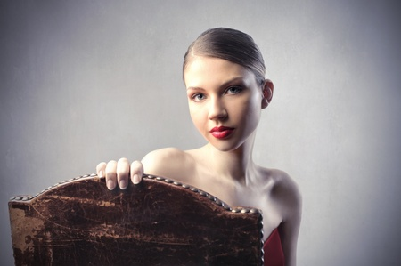 Beautiful elegant woman sitting on an old chair Stock Photo - 9943013