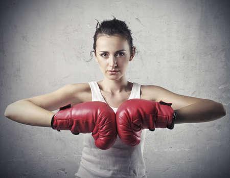 pugilist: Beautiful woman wearing boxing gloves