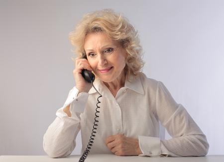 Smiling senior woman talking on the telephone Stock Photo - 9943624