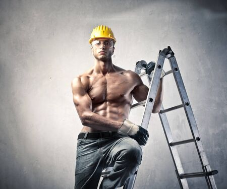 Muscular worker on a ladder Stock Photo - 9943688
