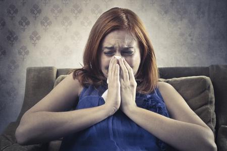 Sad young woman crying photo