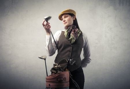 golf equipment: Woman with golf equipment