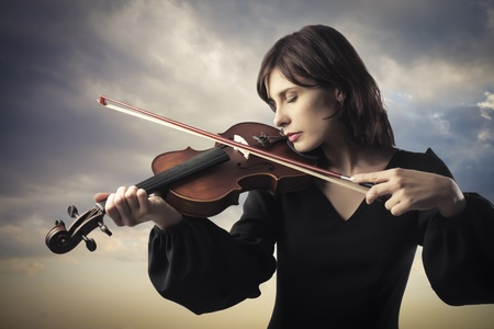 Beautiful woman playing the violin Stock Photo - 10047169