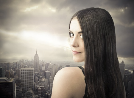 Beautiful woman with cityscape in the background