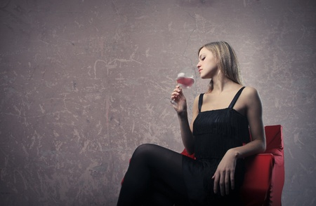 Beautiful woman drinking a glass of wine photo