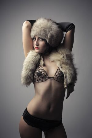 sexy fur: Attractive beautiful woman in lingerie and fur Stock Photo