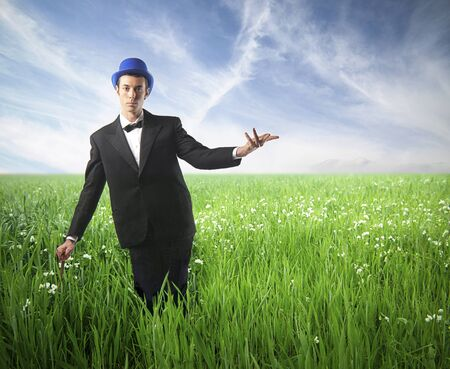 Elegant gentleman on a green meadow photo