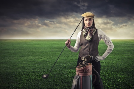 golf equipment: Beautiful woman with golf equipment