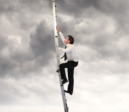 steps to success: Businessman climbing up a ladder  Stock Photo