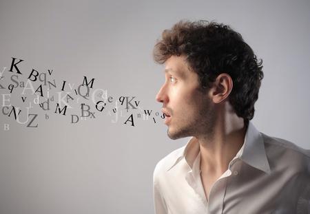 comunicacion oral: Joven hablando con letras del alfabeto que sale de la boca