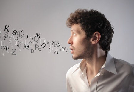 talkative: Young man talking with alphabet letters coming out of his mouth Stock Photo