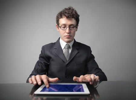 Businessman using a tablet pc photo