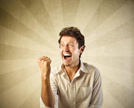 Happy man triumphing Stock Photo - 10223444
